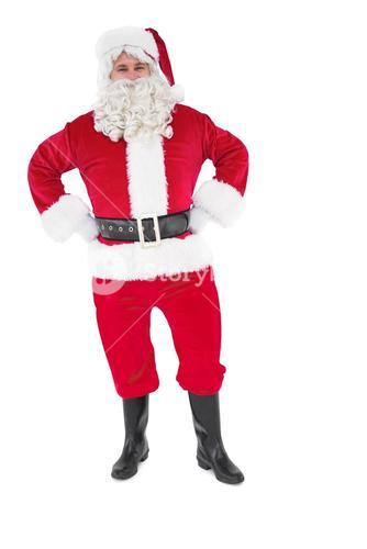 Portrait of santa claus with hands on hips