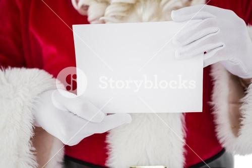 Mid section of santa holding card