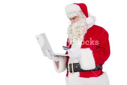 Santa claus shopping online with laptop