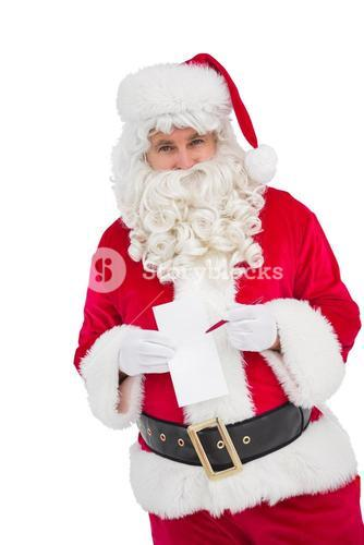 Happy santa holding paper and pen