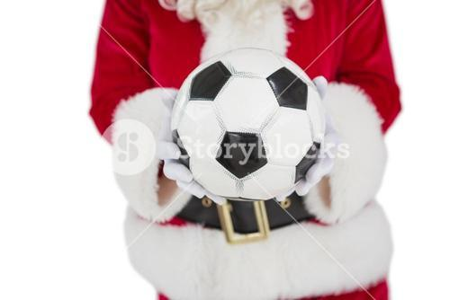 Mid section of santa holding football
