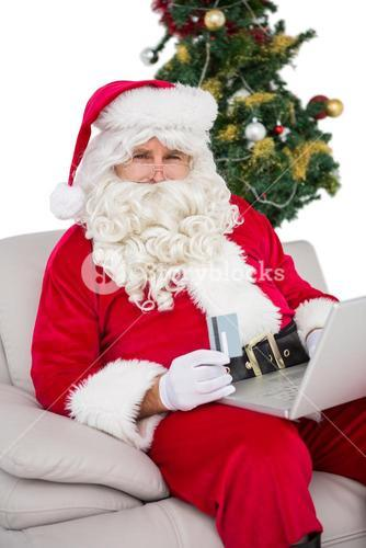 Santa shopping online on the couch