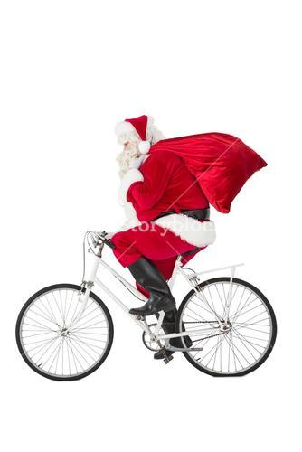 Santa claus delivering gifts with bicycle