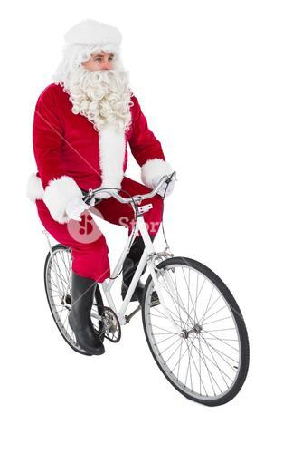 Cheerful father christmas cycling