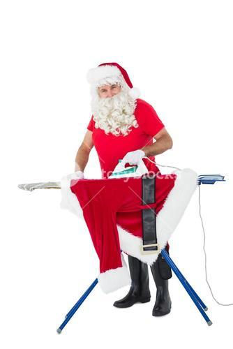 Father christmas ironing his jacket