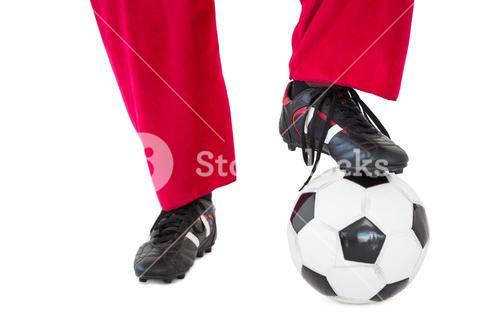 Lower half of santas legs with football boots and football