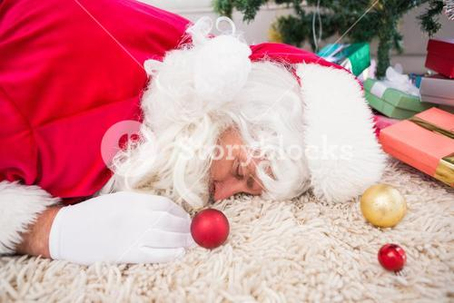Exhausted santa resting on the rug