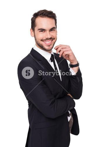 Stylish businessman smiling at camera
