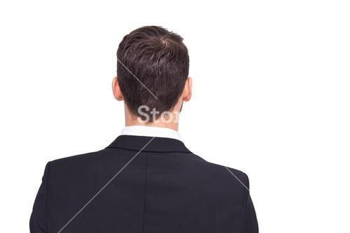Rear view of businessman in suit standing