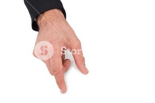 Businessman measuring something with these fingers