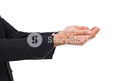 Businessman with arms out presenting something