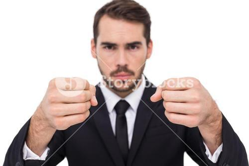 Exasperated businessman with clenched fists