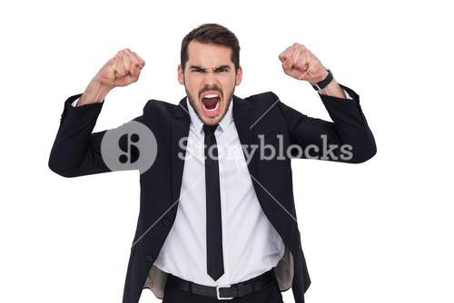 Furious businessman tensing arms muscle