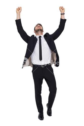 Cheerful businessman with arms up cheering