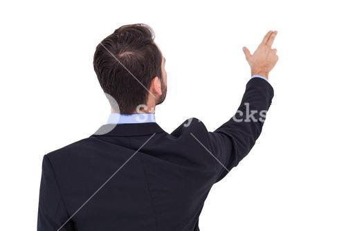 Businessman in suit  pointing these fingers