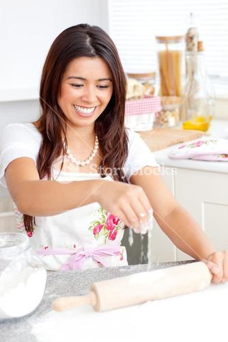 Lively woman baking in the kitchen