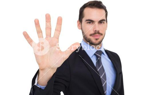 Smiling businessman with fingers spread out