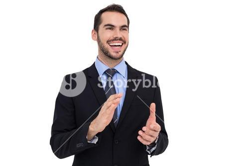 Happy businessman standing and clapping