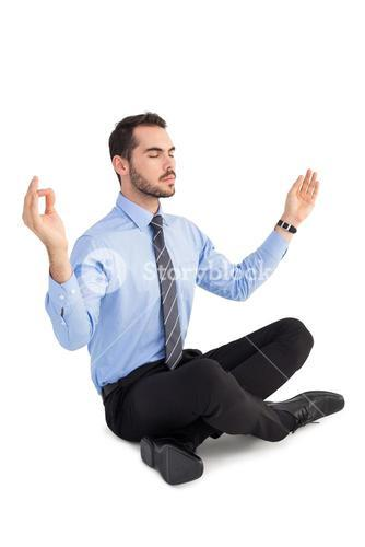 Relaxed businessman sitting in lotus pose