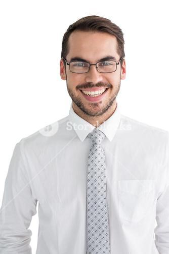 Happy businessman with glasses posing