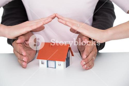Casual couple sheltering small house