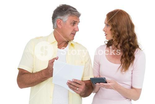Casual couples working out their bills