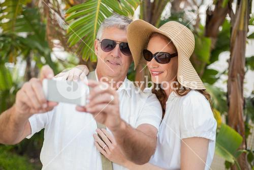 Holidaying couple taking a selfie