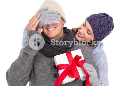 Woman surprising husband with gift