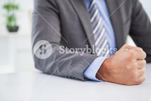 Angry businessman banging his fist