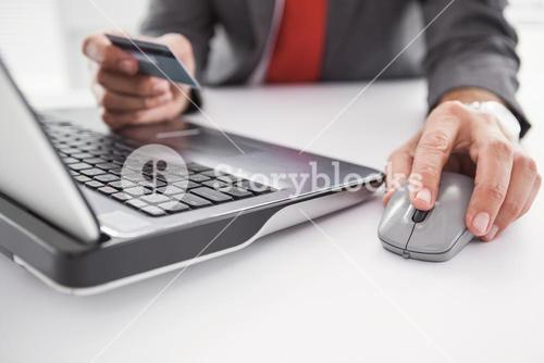 Businessman shopping online on laptop