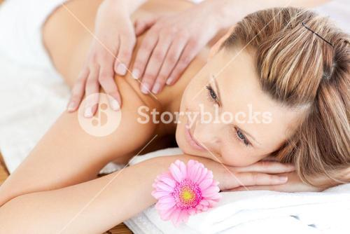 Blissful young woman enjoying a back massage