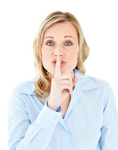 Portrait of a pretty businesswoman asking for silence