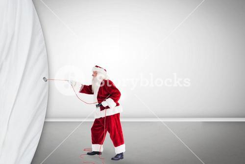 Santa pulls curtain with a rope