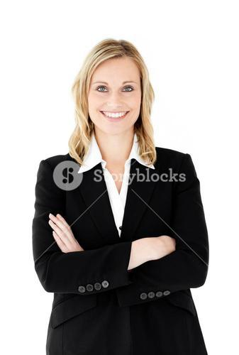 Smiling businesswoman with folded arms looking at the camera