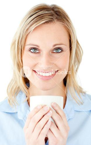 Portrait of a charming businesswoman holding a cup