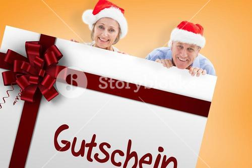 Composite image of festive couple showing poster