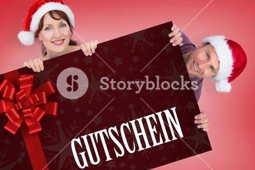 Composite image of couple both wearing santa hats