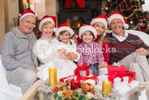 Happy extended family looking at camera at christmas time