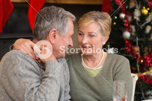 Loving mature couple with arm around