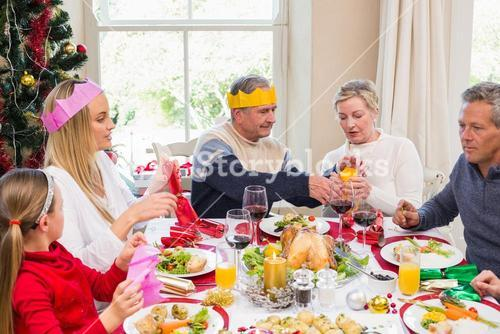 Family in party hat having fun at christmas time