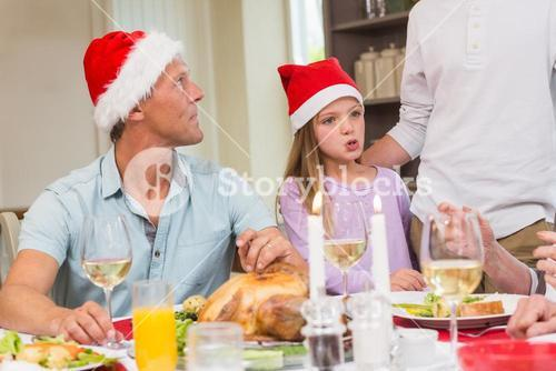 Father and daughter in santa hat at christmas time