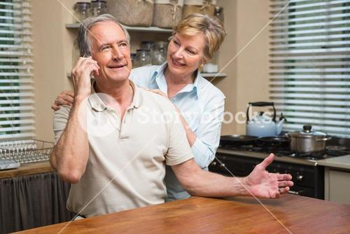 Senior couple on the phone together