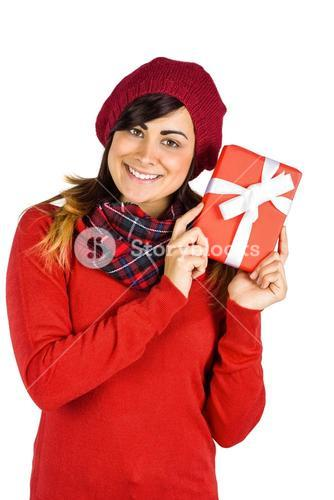 Brunette in red hat holding a gift