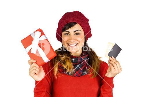 Happy brunette holding gift and cards