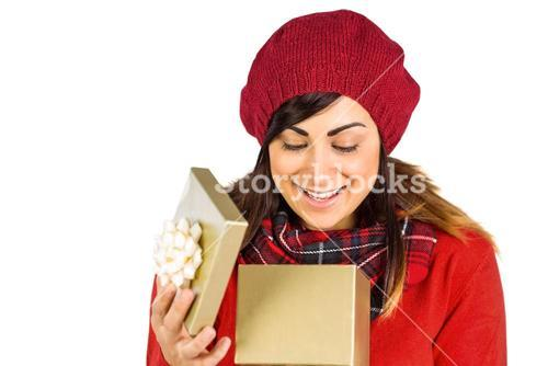 Happy brunette opening christmas gift