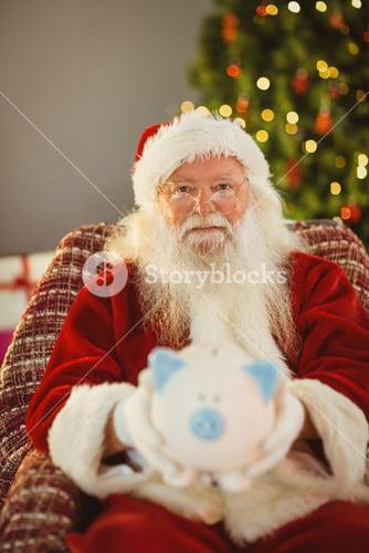 Father christmas offering piggy bank