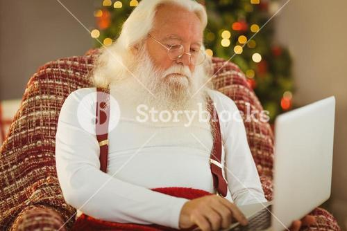 Father christmas typing on laptop