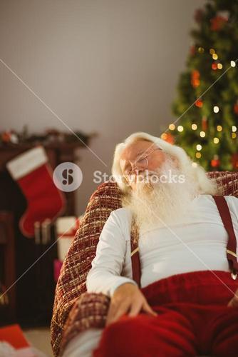 Santa claus resting on the armchair