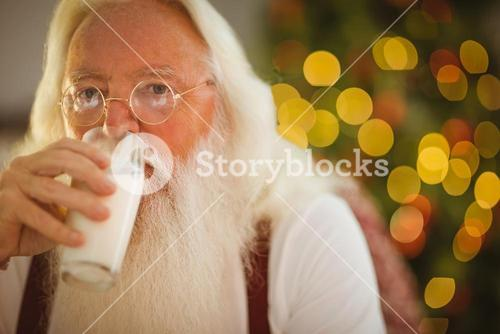 Father christmas drinking glass of milk