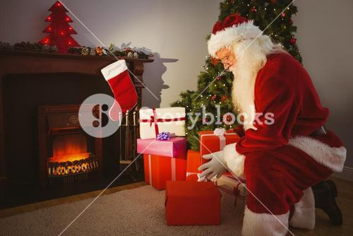 Santa claus delivering gifts at christmas eve